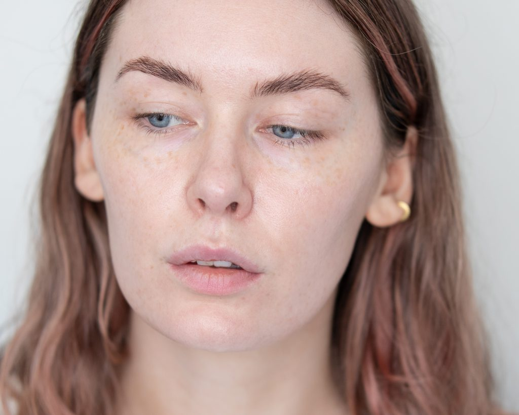 close up image of a person's face with visible freckles
